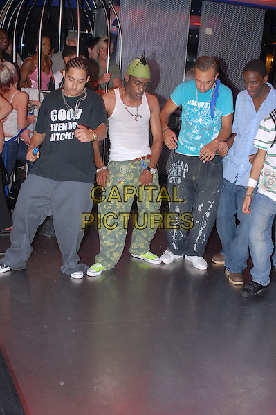 COOLIO (Leon Ivey, Jr.).Performs live at Mayhem Nightclub, Southend, Essex, UK..June 29th, 2006.stage concert gig performance music green bandana  camouflage trousers dancing white full length dancers .CAP/BRC.©Ben Rector/Capital Pictures.
