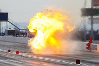 Feb 3, 2017; Chandler, AZ, USA; NHRA top fuel driver Tony Schumacher explodes an engine in a ball of fire during Nitro Spring Training preseason testing at Wild Horse Pass Motorsports Park. Mandatory Credit: Mark J. Rebilas-USA TODAY Sports