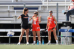 DURHAM, NC - FEBRUARY 16: Campbell assistant coach Taelar Robinson (left) with Sarah Paul (15) and Tina Ricci (1). The Duke University Blue Devils hosted the Campbell University Camels on February 16, 2018, at Koskinen Stadium in Durham, NC in women's college lacrosse match. Duke won the game 18-8.