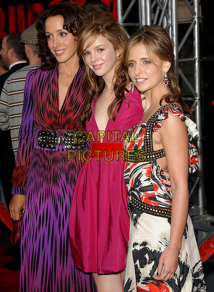 "JENNIFER BEALS, AMBER TAMBLYN & SARAH MICHELLE GELLAR .attends The Columbia Pictures World Premiere of .""The Grudge 2"" held at Knott's Scary Farm in Buena Park, .California, USA, October 8th 2007..half length black and white red patterned print dress long gold studs purple leopard black red print belt.Ref: DVS.www.capitalpictures.com.sales@capitalpictures.com.©Debbie VanStory/Capital Pictures"