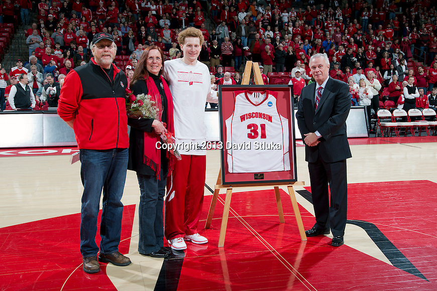 Wisconsin Badgers senior Mike Bruesewitz (31) with his parents and Head Coach Bo Ryan prior to a Big Ten Conference NCAA college basketball game against the Purdue Boilermakers Sunday, March 3, 2013, in Madison, Wis. Purdue won 69-56. (Photo by David Stluka)