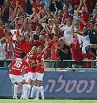 Nemanja Vucicevic celebrates after scoring for Hapoel