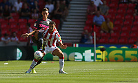 Stoke City's Lee Gregory shields the ball from Leeds United's Stuart Dallas<br /> <br /> Photographer Stephen White/CameraSport<br /> <br /> The Premier League - Stoke City v Leeds United - Saturday August 24th 2019 - bet365 Stadium - Stoke-on-Trent<br /> <br /> World Copyright © 2019 CameraSport. All rights reserved. 43 Linden Ave. Countesthorpe. Leicester. England. LE8 5PG - Tel: +44 (0) 116 277 4147 - admin@camerasport.com - www.camerasport.com