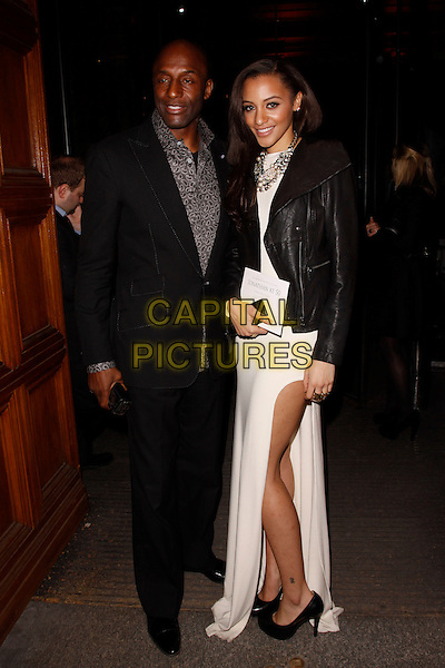 John and Amal Fashanu.The talent agent Jonathan Shalit's 50th birthday party, V&A Museum, London, England..April 17th, 2012.full length white slit split dress black leather jacket clutch bag grey gray shirt suit father dad daughter family .CAP/AH.©Adam Houghton/Capital Pictures.