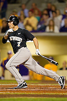 Mac Williamson #7 of the Wake Forest Demon Deacons follows through on his swing against the LSU Tigers at Alex Box Stadium on February 18, 2011 in Baton Rouge, Louisiana.  The Tigers defeated the Demon Deacons 15-4.  Photo by Brian Westerholt / Four Seam Images