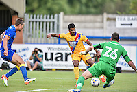 Frazer Campbell of Crystal Palace (center) runs with the ball towards Ryan Clarke of AFC Wimbledon , during the Friendly match between AFC Wimbledon and Crystal Palace at the Cherry Red Records Stadium, Kingston, England on 27 July 2016. Photo by Edward Thomas / PRiME Media Images.