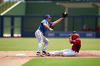 GCL Mets second baseman Patrick Causa (7) stretches for a throw as Viandel Pena (41) steals during a Gulf Coast League game against the GCL Nationals on August 12, 2019 at FITTEAM Ballpark of the Palm Beaches in Palm Beach, Florida.  GCL Nationals defeated the GCL Mets 7-3.  (Mike Janes/Four Seam Images)