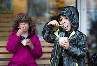 NWA Democrat-Gazette/CHARLIE KAIJO Henry Sosa, 4, (from right) and Lucy Sosa, 6, of Kansas City Mos. eat ice cream, Thursday, March 29, 2018 at The Walmart Museum at Bentonville Square in Bentonville. <br />