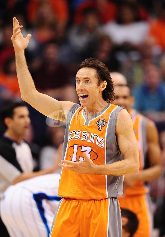 Mar. 25, 2011; Phoenix, AZ, USA; Phoenix Suns guard (13) Steve Nash reacts against the New Orleans Hornets at the US Airways Center. The Hornets defeated the Suns 106-100. Mandatory Credit: Mark J. Rebilas-.