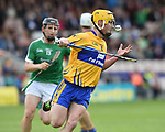 Colm Galvin of Clare in action against Peter Casey of Limerick  during their Munster Championship semi-final at Thurles.  Photograph by John Kelly.