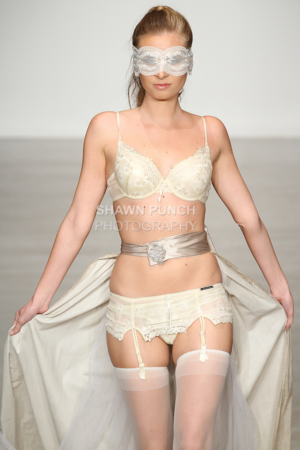 Model walks runway in lingerie from the Zumruduanka collection by Kiymet and B. Nimet Ulubay, for the Lingerie Fashion Week SS15 Official Closing Show, during LingerieFW Spring Summer 2015.
