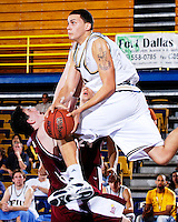 13 January 2007: Florida International University Alex Galindo (in white) collides with Denver center Adam Tanner (12) while coming down with a rebound in the second half of the FIU 61-59 victory over Denver at the Pharmed Arena in Miami, Florida.