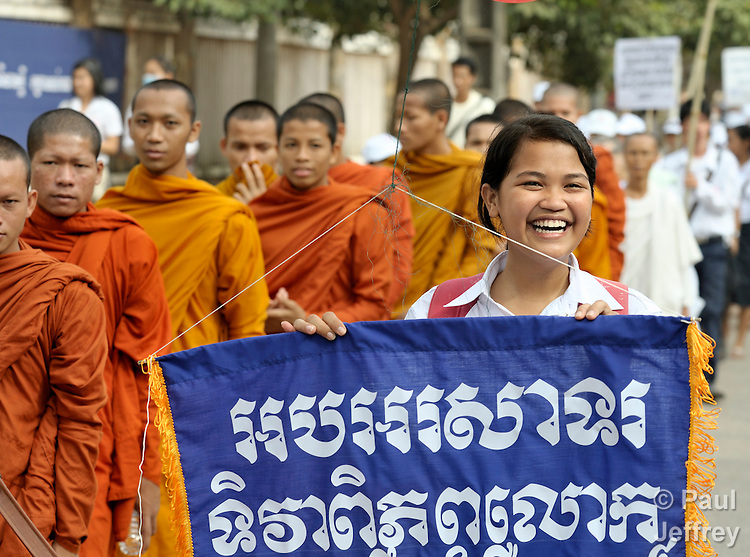 Nith Nitikar, an 18-year old student, walks with Buddhist monks to lead a march commemorating World AIDS Day in Battambang, Cambodia. Among sponsors of the march was the Salvation Centre Cambodia, an organization that works with Buddhist monks and other activists to foster support for people living with HIV and AIDS as well as public education and advocacy throughout the country.