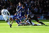 Neil Etheridge of Cardiff City vies for possession with Wayne Routledge of Swansea City during the Sky Bet Championship match between Swansea City and Cardiff City at the Liberty Stadium in Swansea, Wales, UK. Sunday 27 October 2019