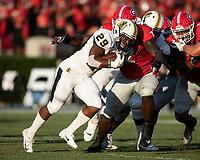 ATHENS, GA - SEPTEMBER 7: Netori Johnson #72 prepares to tackle running back MJ Fuller #29 during a game between Murray State Racers and University of Georgia Bulldogs at Sanford Stadium on September 7, 2019 in Athens, Georgia.