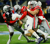 From left, Ohio State Buckeyes safety Jordan Fuller (4), Ohio State Buckeyes cornerback Kendall Sheffield (8) and Ohio State Buckeyes linebacker Pete Werner (20) combine for a tackle on Northwestern Wildcats wide receiver Bennett Skowronek (88) during the second quarter of the Big Ten Conference Football Championship between the Ohio State Buckeyes and the Northwestern Wildcats on Saturday, December 1, 2018 at Lucas Oil Stadium in Indianapolis, Indiana. [Joshua A. Bickel/Dispatch]