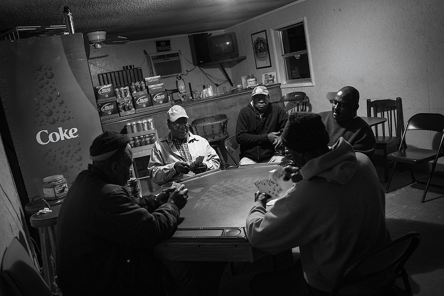An almost nightly occurrence, Geechee men of Hog Hammock play cards in the Trough, the only bar on Sapelo Island.