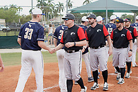 Edgewood Eagles coaching staff shakes hands after the second game of a double header against the Bethel Wildcats on March 15, 2019 at Terry Park in Fort Myers, Florida.  From left, Al Brisack, Ralph Kalal, Ryan O'Dell, and Brodie Engel.  Bethel defeated Edgewood 3-2.  (Mike Janes/Four Seam Images)