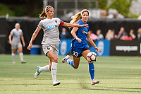 Seattle, WA - Sunday, August 13, 2017: Katlyn Johnson and Abby Erceg during a regular season National Women's Soccer League (NWSL) match between the Seattle Reign FC and the North Carolina Courage at Memorial Stadium.