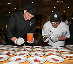 Chef Ivano Centemeri, left, prepares a dish during the Big Chefs, Big Gala event at the Grand Sierra Resort in Reno on April 8, 2017.