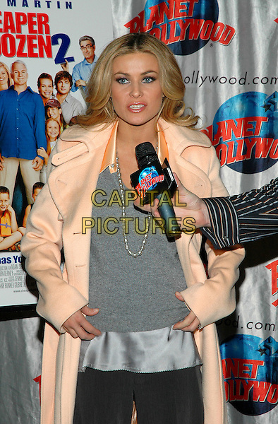 "CARMEN ELECTRA.Promotes her new film, ""Cheaper By The Dozen 2"" at Planet Hollywood in Times Square in New York City. .December 19th, 2005.Photo: Patti Ouderkirk/AdMedia/Capital Pictures.Ref: PO/ADM.half length grey gray top pearl necklace peach coat microphone interview.www.capitalpictures.com.sales@capitalpictures.com.© Capital Pictures."