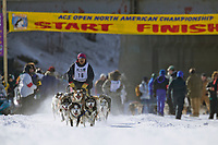 John Gallahorn and team at the start of the oldest continuously run sled dog race in the world, the 2003 Open North American Sled dog championships which start on the Chena River in downtown Fairbanks, Alaska. The annual race consists of three daily races, the combined fastest time wins.