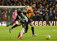 Newcastle United's Christian Atsu under pressure from Wolverhampton Wanderers' Joao Moutinho <br /> Photographer Lee Parker/CameraSport<br /> <br /> The Premier League - Wolverhampton Wanderers v Newcastle United - Saturday 11th January 2020 - Molineux - Wolverhampton<br /> <br /> World Copyright © 2020 CameraSport. All rights reserved. 43 Linden Ave. Countesthorpe. Leicester. England. LE8 5PG - Tel: +44 (0) 116 277 4147 - admin@camerasport.com - www.camerasport.com