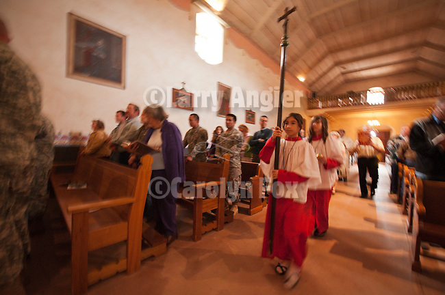 Altar girls lead the grand entrance into the chapel during Easter Service, Mission San Antonio de Padua, California.