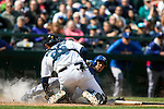 Texas Rangers'  base runner  Leury Garcia is tagged out while trying to score from third by Seattle Mariners' catcher Jesus Montero in the fifth inning April 14, 2013 at Safeco Field in Seattle.  © 2013. Jim Bryant Photo. All Rights Reserved.