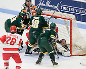 Holly Lorms (BU - 8) and Jill Cardella (BU - 22) wind up in the net with Roxanne Douville (Vermont - 34) - The Boston University Terriers tied the visiting University of Vermont Catamounts 2-2 on Saturday, November 13, 2010, at Walter Brown Arena in Boston, Massachusetts.