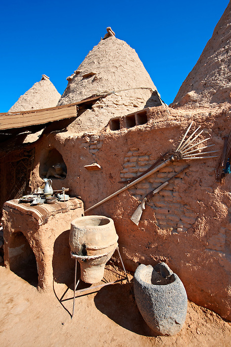 "Pictures of the beehive adobe buildings of Harran, south west Anatolia, Turkey.  Harran was a major ancient city in Upper Mesopotamia whose site is near the modern village of Altınbaşak, Turkey, 24 miles (44 kilometers) southeast of Şanlıurfa. The location is in a district of Şanlıurfa Province that is also named ""Harran"". Harran is famous for its traditional 'beehive' adobe houses, constructed entirely without wood. The design of these makes them cool inside. 12"