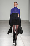 """Model walks runway in an outfit from the Zang Toi Fall 2017 """"Brilliant Royal Blue"""" collection, at Pier59 Studios on February 13, 2017; during NYFW: The Shows Fall Winter 2017."""