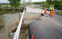 NWA Democrat-Gazette/DAVID GOTTSCHALK   Washington County Road Department personnel survey the damage Monday, May 1, 2017, on WC Road 859 next to the bridge over Clear Creek in Wheeler. Heavy rains caused flooding from local area creeks including Clear Creek damaging sections of the road and personal property in the area.