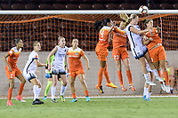 Houston, TX - Saturday July 08, 2017: Lindsey Horan and Sarah Hagen go up for a header during a regular season National Women's Soccer League (NWSL) match between the Houston Dash and the Portland Thorns FC at BBVA Compass Stadium.