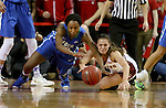 VERMILLION, SD, APRIL 2:  DyTiesha Dunson #0 from Florida Gulf Coast battles for the loose ball with Tia Hemiller #4 from the University of South Dakota during the WNIT Championship game Saturday afternoon at the Dakota Dome in Vermillion, S.D. (Photo by Dave Eggen/Inertia)