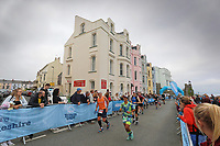 Pictured: Marathon runners on the Esplanade, Tenby. Sunday 15 September 2019<br /> Re: Ironman triathlon event in Tenby, Wales, UK.