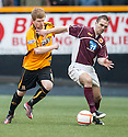 Alloa's Ryan McCord and Stenny's David Rowson challenge for the ball.