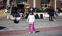 Pictured: A young girl at the port Thursday 03 March 2016<br /> Re: Migrants have been gathering at the port of Piraeus, near Athens, Greece