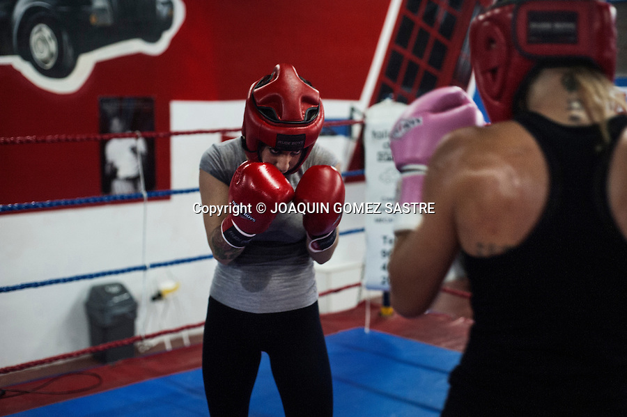 The Fatima Martin trained boxer in the ring boxing club Elche with a partner