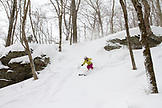 Vermont, Stowe Mountain, Louise Lintilhac skiing the glades at The Bench down to Mountain Road
