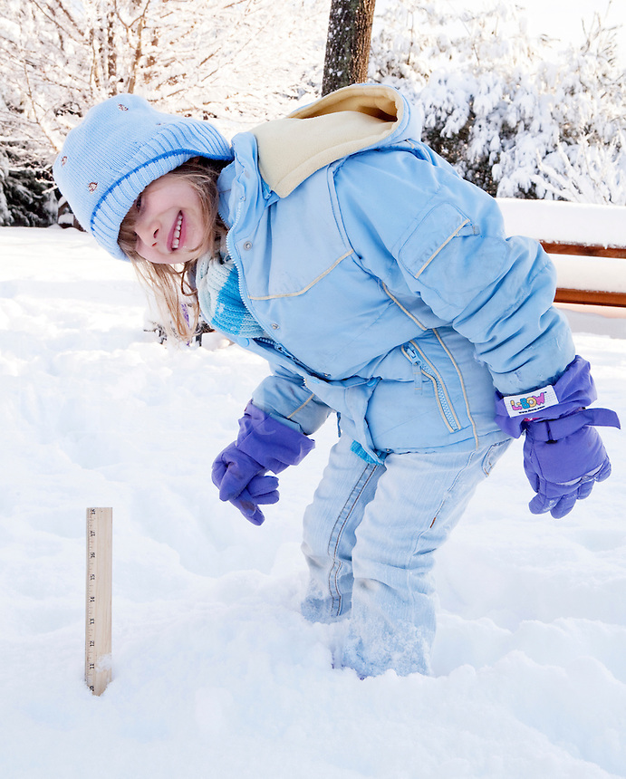 Young Girl measuring snow