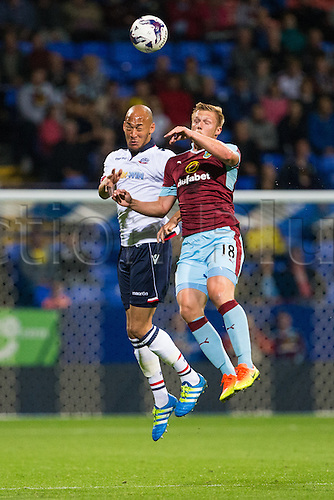 26.07.2016. Macron Stadium, Bolton, England. Pre Season Football Friendly. Bolton Wanderers versus Burnley. Burnley FC forward Rouwen Hennings fights for the header.
