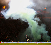 2nd November 2019; Hampden Park, Glasgow, Scotland; Scottish League Cup Football, Hibernian versus Celtic; Fraser Forster of Celtic stands in front of the Celtic support as smoke billows from pyro  - Editorial Use