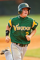 Garrett Freeze #2 of the Central Cabarrus Vikings rounds the bases after hitting a home run against the Northwest Cabarrus Trojans on April 30, 2012 in Kannapolis, North Carolina.  The Trojans defeated the Vikings 8-2.  (Brian Westerholt/Four Seam Images)