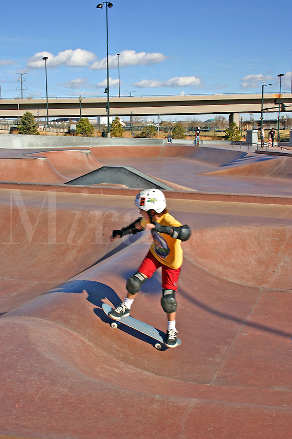 Children skateboarding Denver Skatepark Colorado