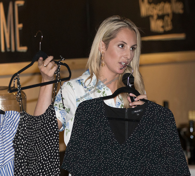 Emily Farren Wieczorek shows some of the looks for fall during Reno Magazine's Fall Fashion Styling at the Whispering Vine Wine Co. on Saturday, August 19, 2017.