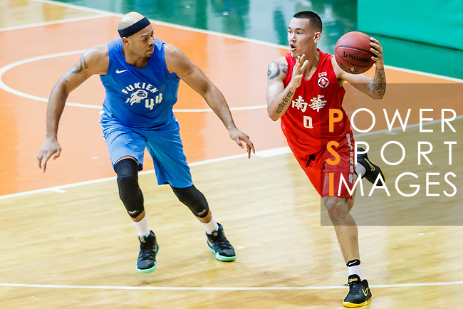 Glen Tang Robertson #00 of SCAA Men's Basketball Team dribbles the ball up court against the Fukien during the Hong Kong Basketball League game between SCAA and Fukien at Southorn Stadium on June 01, 2018 in Hong Kong. Photo by Yu Chun Christopher Wong / Power Sport Images