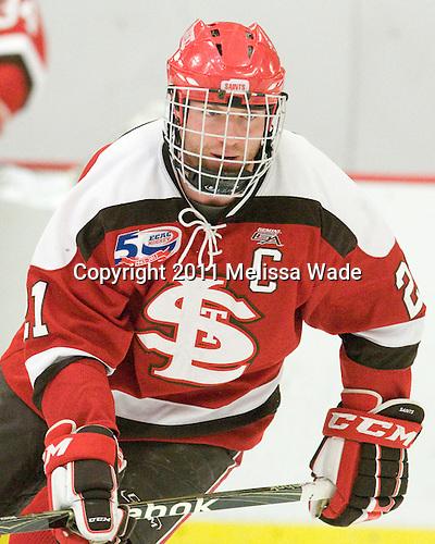 Jared Keller (St. Lawrence - 21) - The Harvard University Crimson defeated the St. Lawrence University Saints 4-3 on senior night Saturday, February 26, 2011, at Bright Hockey Center in Cambridge, Massachusetts.