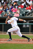 Montgomery Biscuits outfielder Joey Rickard (7) at bat during a game against the Mississippi Braves on April 22, 2014 at Riverwalk Stadium in Montgomery, Alabama.  Mississippi defeated Montgomery 6-2.  (Mike Janes/Four Seam Images)