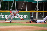 Auburn Doubledays third baseman Colton Pogue (6) tags Dalvy Rosario (17) sliding in during a NY-Penn League game against the Batavia Muckdogs on June 19, 2019 at Dwyer Stadium in Batavia, New York.  Batavia defeated Auburn 5-4 in eleven innings in the completion of a game originally started on June 15th that was postponed due to inclement weather.  (Mike Janes/Four Seam Images)